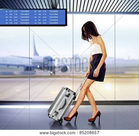 tourist info signage in airport and beautiful passenger with luggage
