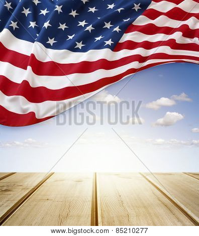 American flag in blue sky above boardwalk