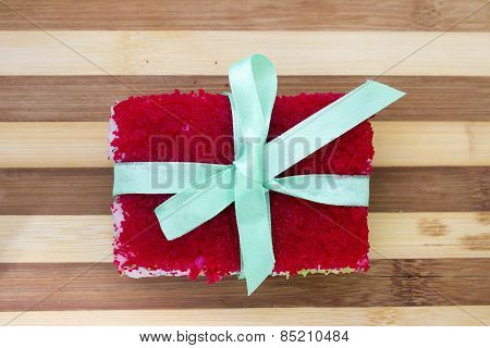 Rolls With A Ribbon On A Cutting Board Isolated Overwhite