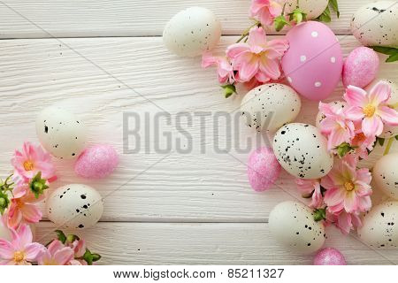 easter eggs and flowers frame background