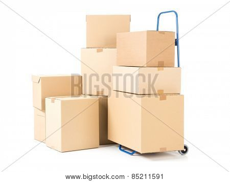 Hand truck and pile of cardboard boxes on white background