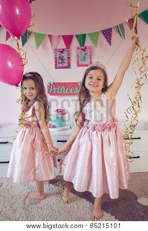 Celebrating princess birthday party of two 6 years old sisters