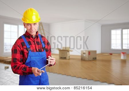 Craftsman with folding rule standing in a room during renovation (3D Rendering of background)