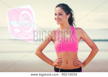Beautiful smiling healthy with earphones on beach against fitness interface