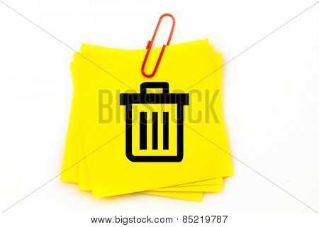 Trash can against sticky note with red paperclip