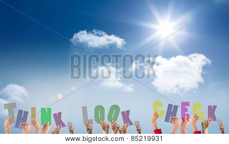 Hands holding up think look check against bright blue sky with clouds
