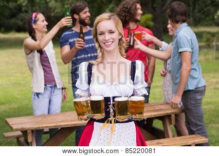 Group of friends celebrating oktoberfest on a sunny day