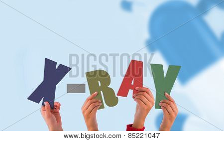 Hands holding up xray against blue medical background with pills
