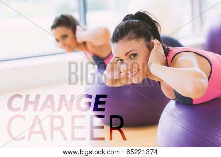 Portrait of two fit women exercising on fitness balls against change career