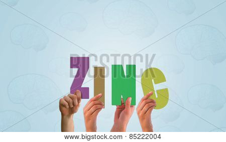 Hands holding up zinc against blue brain pattern background