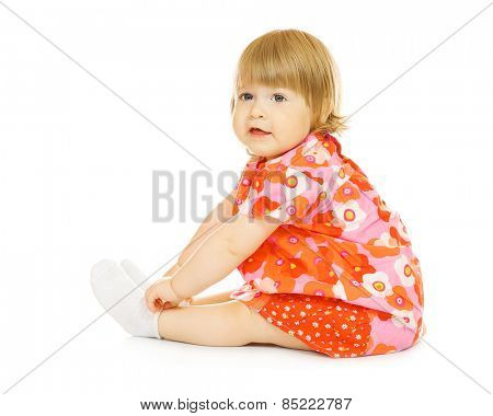 Small smiling baby in red dress isolated on white