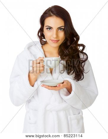 Young girl with bathrobe and cup isolated