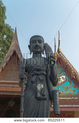 monk statue with temple background