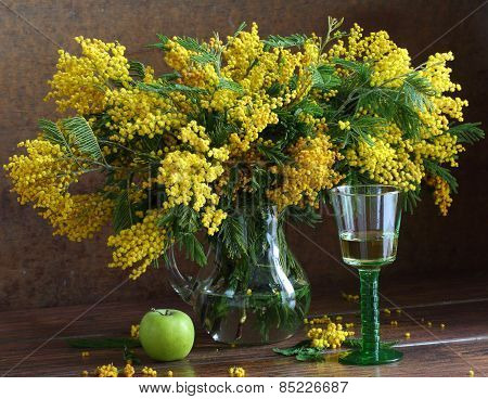 Glass Of Wine And Bouquet Of A Yellow Mimosa At A Window