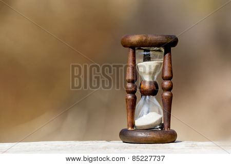 abstract hourglass on wooden surface