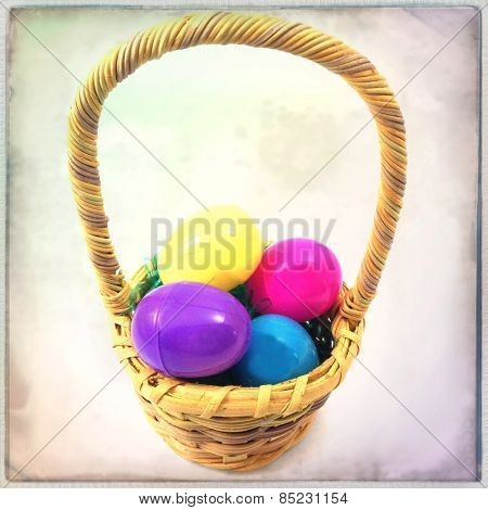 Instagram filtered image of an easter basket and plastic eggs with grain