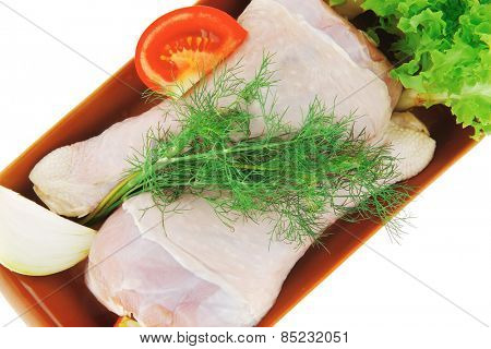 chicken drumstick and green lettuce over white background