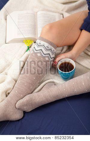 Female legs in warm woolen socks.