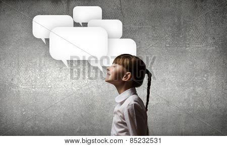 Girl of school age and speech balloons above her head