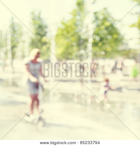 Abstract blurred image of city street scene.