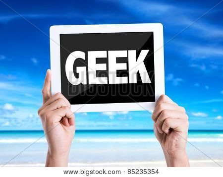 Tablet pc with text Geek with beach background