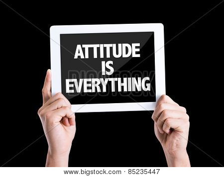 Tablet pc with text Attitude is Everything isolated on black background