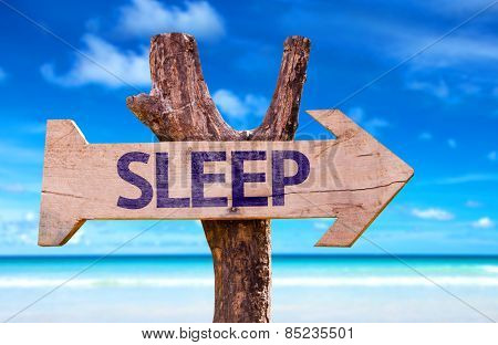 Sleep wooden sign with beach background