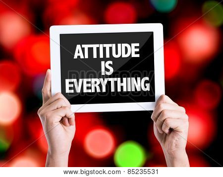 Tablet pc with text Attitude is Everything with bokeh background