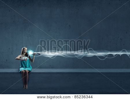 Young woman playing violin against blank background