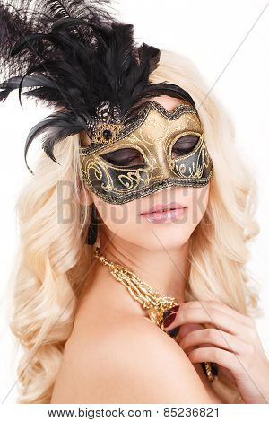 Fashion studio portrait of sensual woman with luxurious blond hair with mask on face.