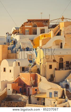 Typical and amazing colorful street in Oia city, Santorini, Greece