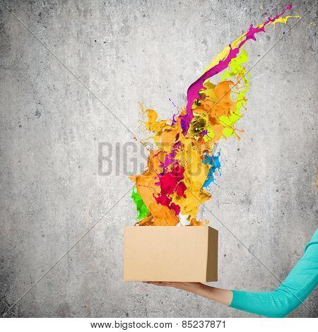 Close up of woman hand holding carton box