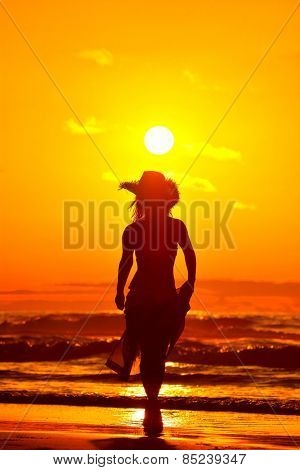 young woman on the beach in summer evening