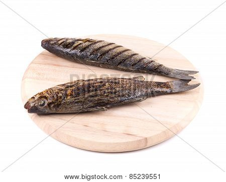 grilled seabass fish on platter