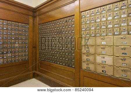 Mailboxes lined up in a post office.