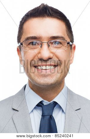 business, people, vision and office concept - happy smiling businessman in eyeglasses and suit