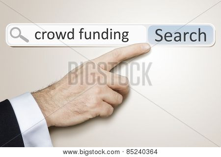 An image of a man who is searching the web after crowd funding