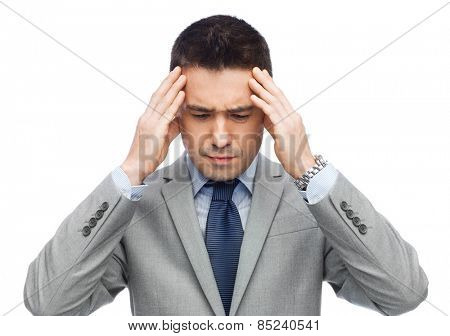 business, people, crisis and fail concept - businessman in suit having head ache