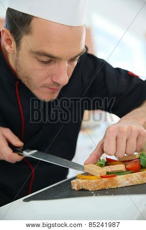 Chef preparing delicatessen disg