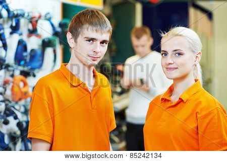 Positive team of sellers or shop assistant group portrait  in supermarket store