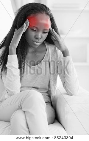 Close up of young woman having a headache