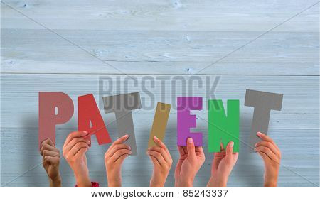 Hands holding up patient against bleached wooden planks background