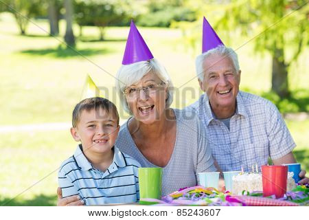 Happy grandparents with their grandson on a sunny day