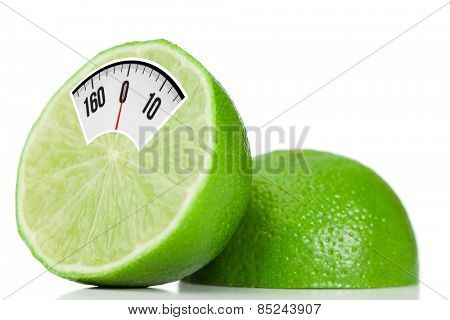 weighing scales against halved lime