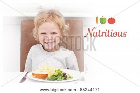 The word nutritious against cute little boy eating pasta and salad