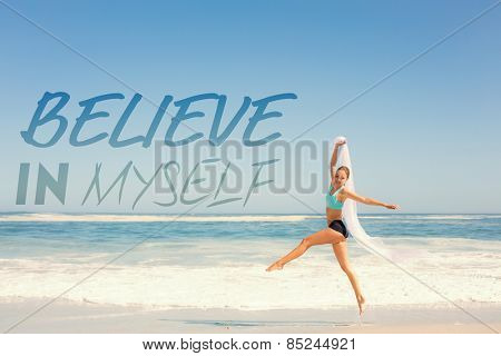 Fit woman jumping gracefully on the beach with scarf against believe in myself