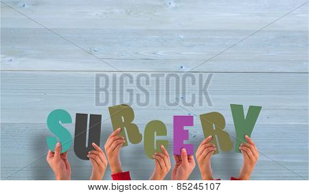 Hands holding up surgery against bleached wooden planks background