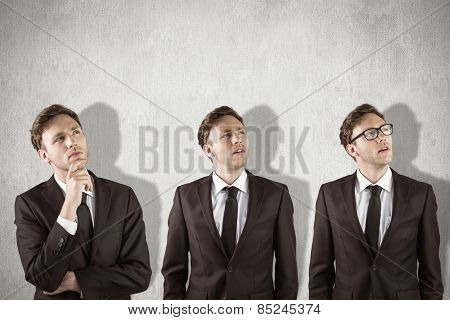 Nerdy businessman thinking against white and grey background