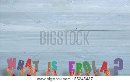 Hands holding up ebola question against bleached wooden planks background