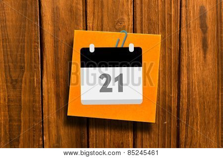 Calander against orange adhesive note with a paperclip